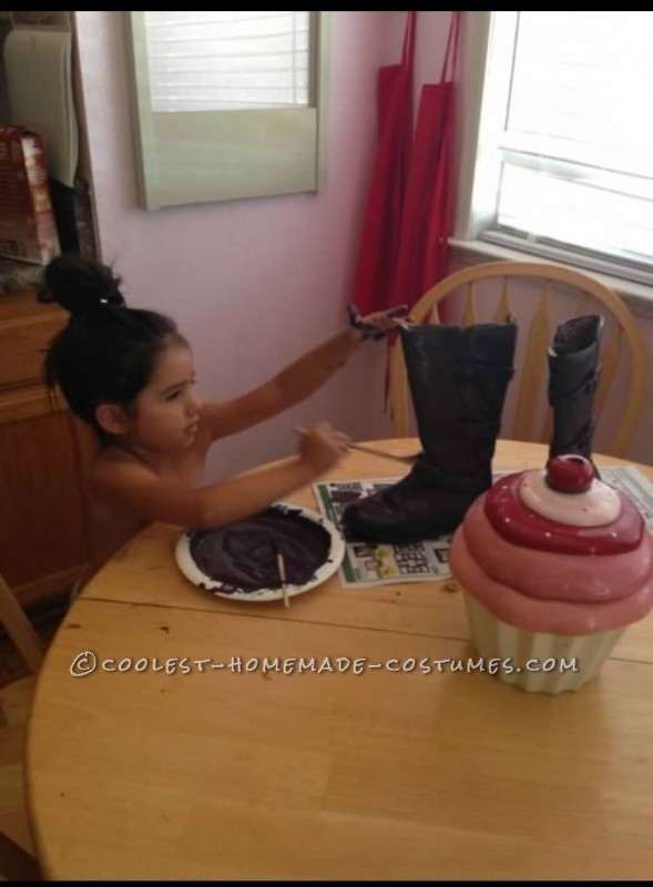 my daughter helping me paint Skeletor's boots.