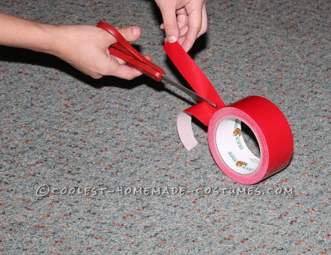 Cutting the Red Duct Tape in Thin Strips