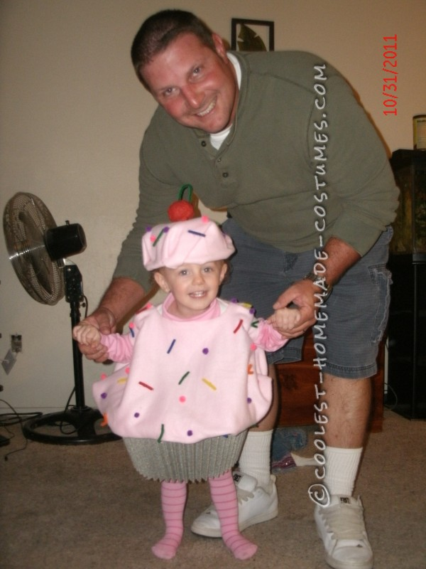 Vivian and her Daddy posing the cupcake costume