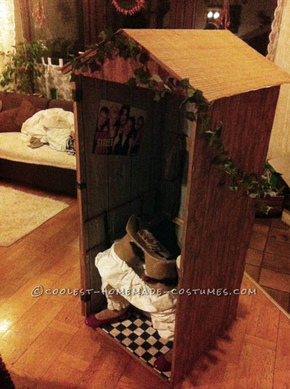 Funny Illusion Costume: Traditional Bavarian Woman Sitting on Wooden Toilet