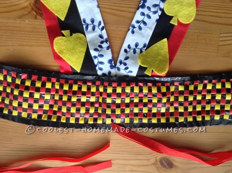 Insulation tape belt and cotton/felt shoulder straps.