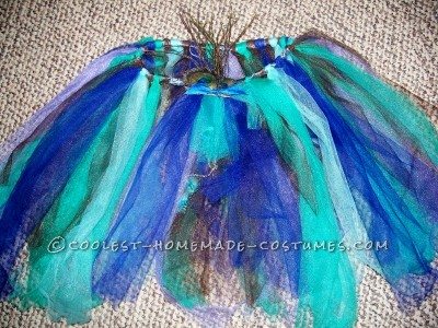 Tulle tutu with feather brooch attached