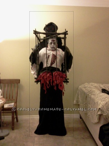 Grim Reaper with Half Zombie in a Cage Illusion Costume