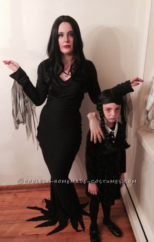 Morticia and Wednesday Addams with Thing