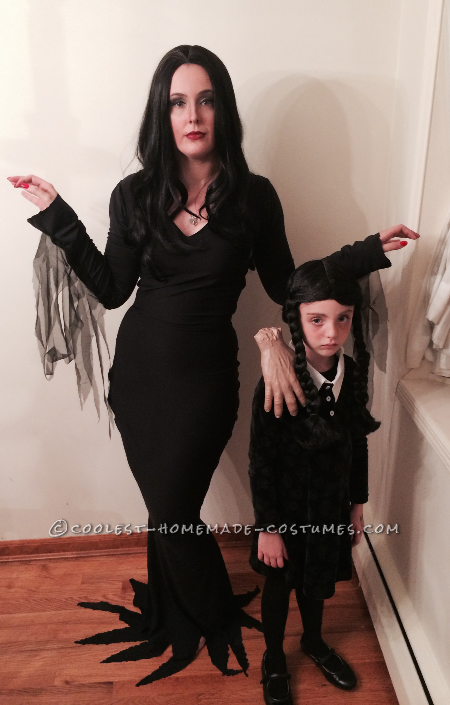 Cool Homemade Mom and Daughter Couple Costume: Morticia and Wednesday Addams with Thing