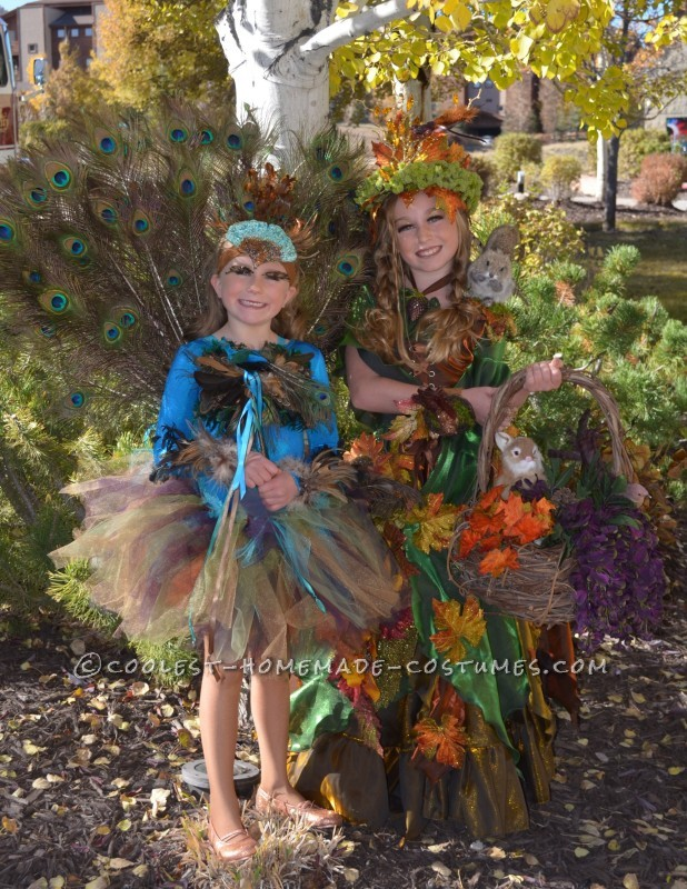 Both of my girls--Mother Nature & our crafted Peacock costume from a few years back