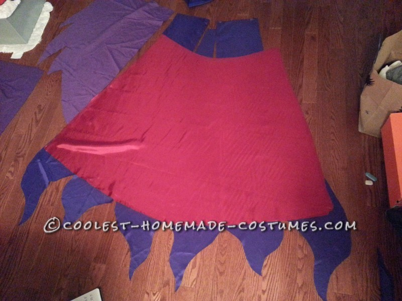 Here is the  inner flap which I cut into three pieces then sew them together. It creates a 'fan' shape, making the back appear bigger. The pink fabric is used to make the dress I will wear inside.