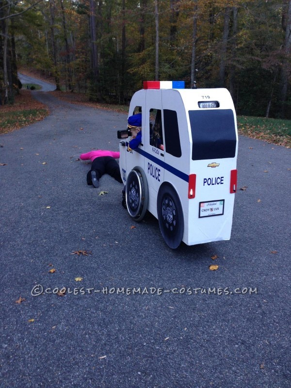Carly's Cop Car Wheelchair Costume - 3