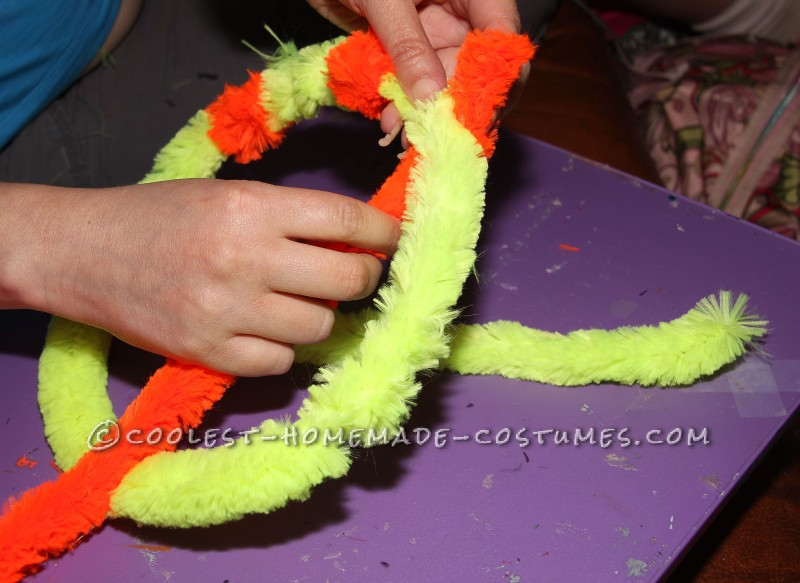 Twisting Chenille Stems for Magnifying Glass
