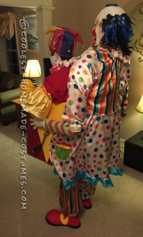 Scary Clown Carrying A Jack In The Box Illusion Costume