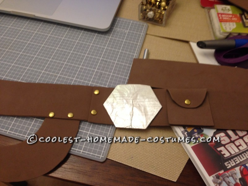 Han's Belt made from foam sheets held together with brads and glue.  Buckle made of cardboard and aluminum foil