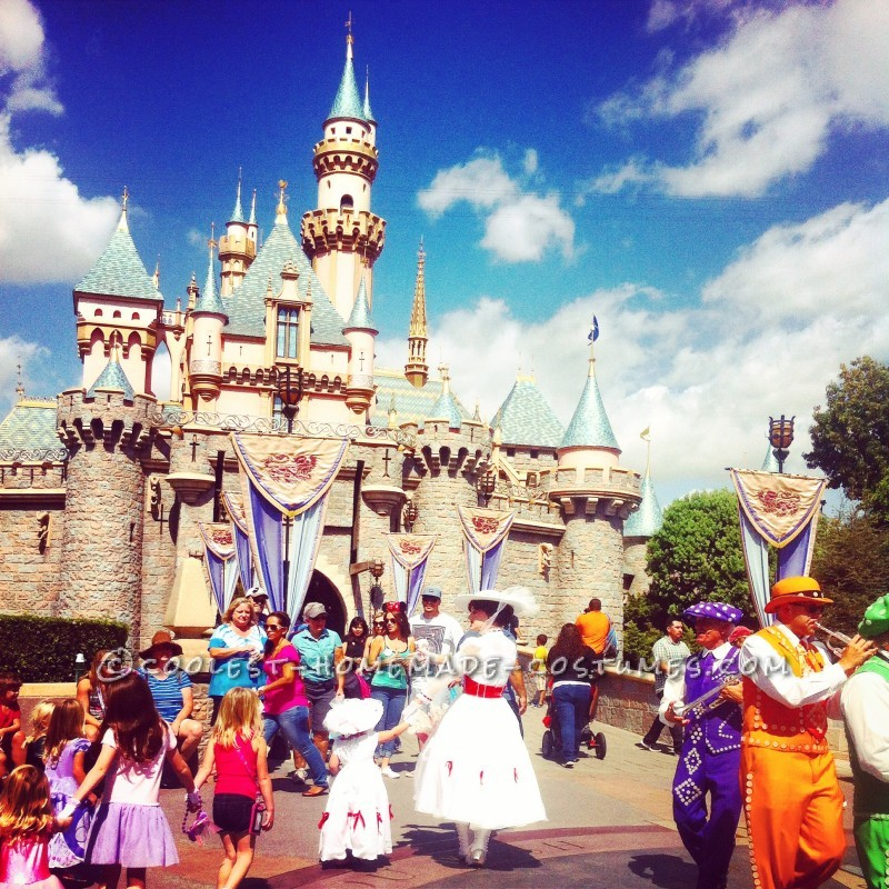Shaylee Poppins and Mary Poppins in front of Sleeping Beauty's castle