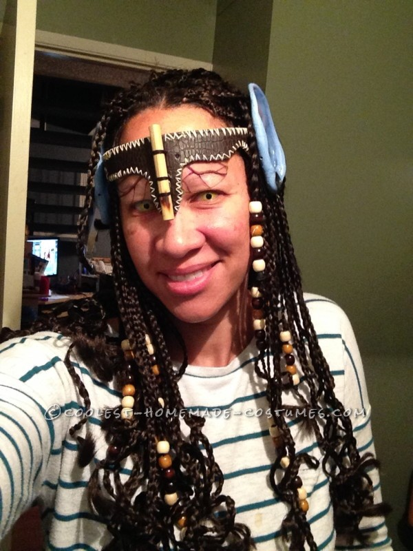 Hair braided and headpiece made with yellow contacts