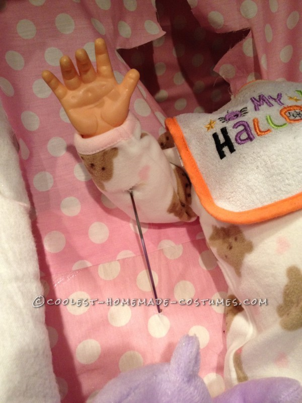 5)  Add skewer to work arms of doll