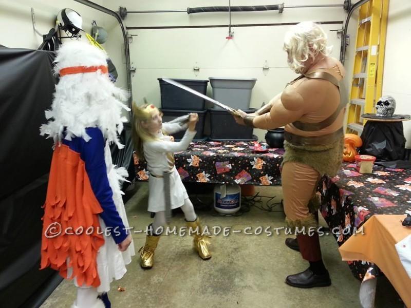 He-man battles She-ra, while Sorceress looks on