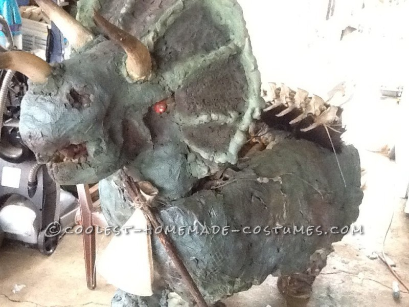Triceratops  with light up eyes , smoke comes out his nose and his tongue moves