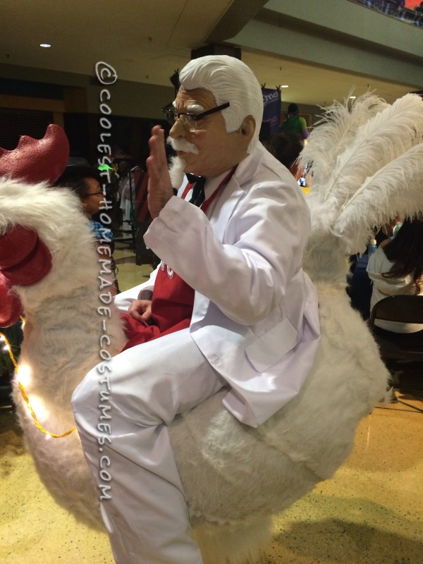 Coolest Colonel Sanders Costume Riding a Giant Chicken!