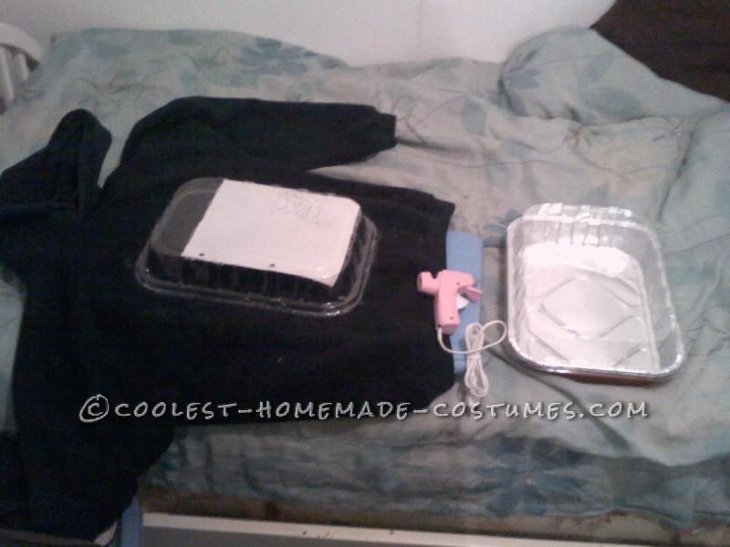 Old hoodie+hot glue+ plastic pan lid=stomach