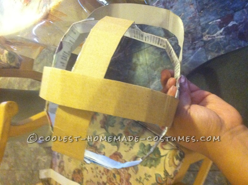1.Make a round hat out of cardboard(you do not need to add that strip of cardboard sticking out)