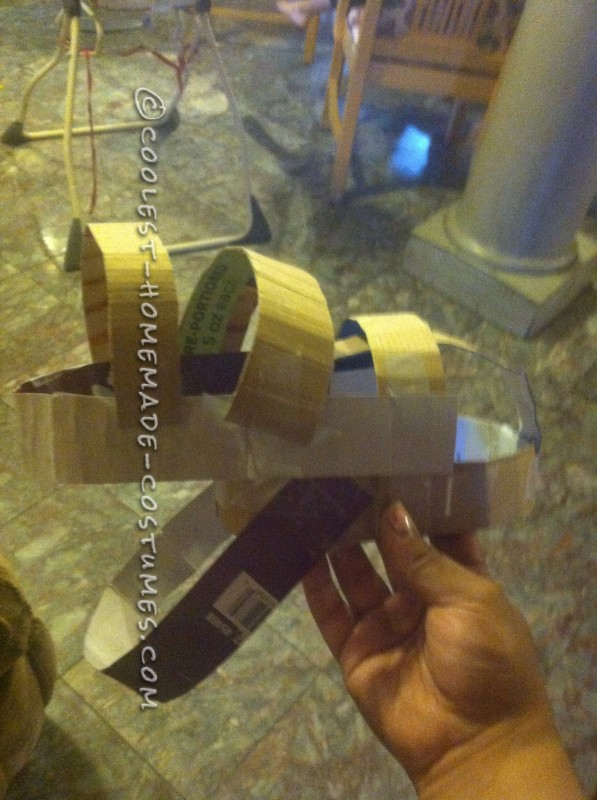 2. Add the a long strip of cardboard to go around the top of the hat