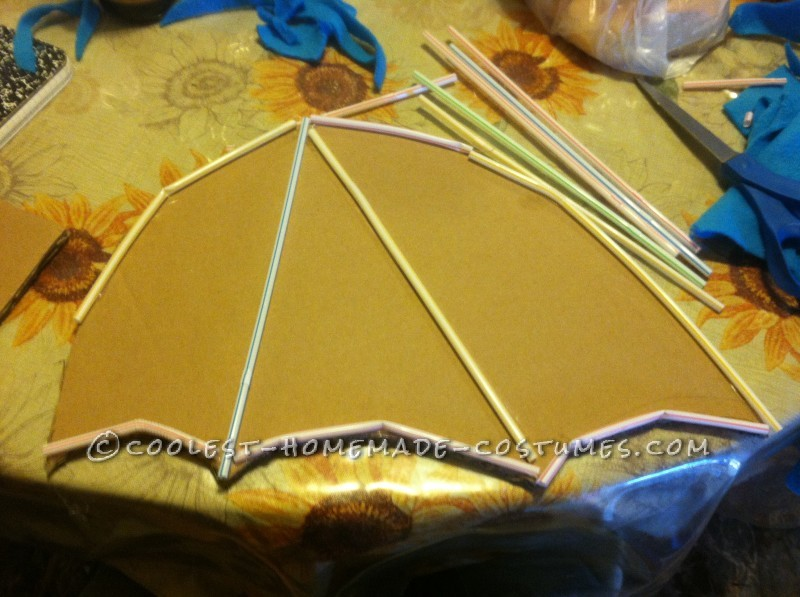 1. Cut out cardboard wings and glue straws or whatever you have on both sides of the wings.