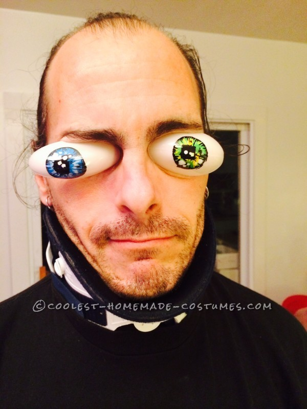 Detailed of plastic painted eyes. Note he was injured with a broken back and neck, but yet working on this dream costume!