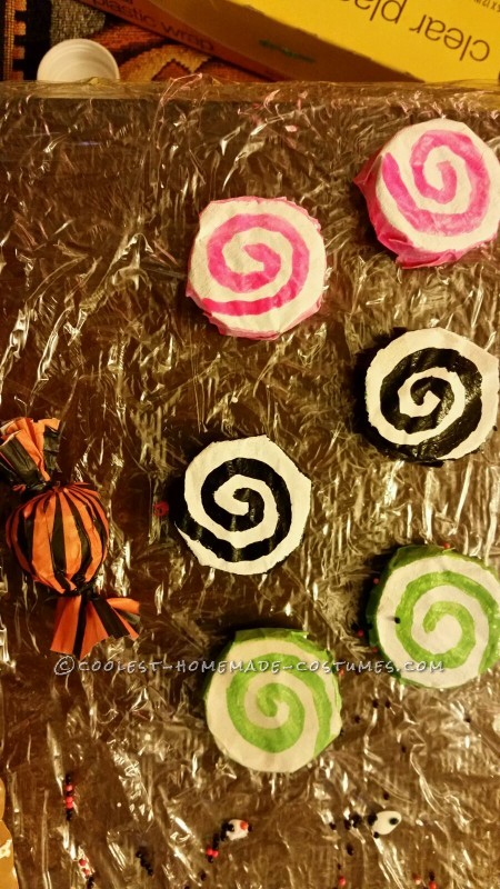 Candy created using tealight candles covered in masking tape and painted swirls