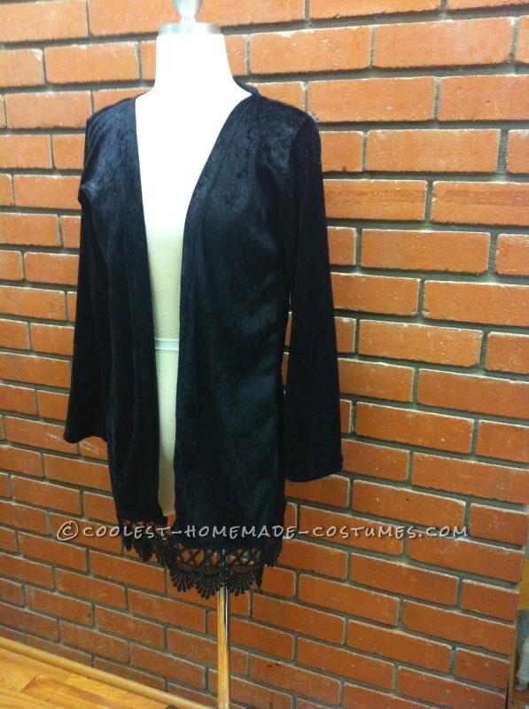 Black velvet overcoat with lace trim