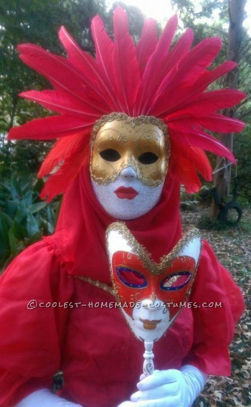 a close up of both the female masks.