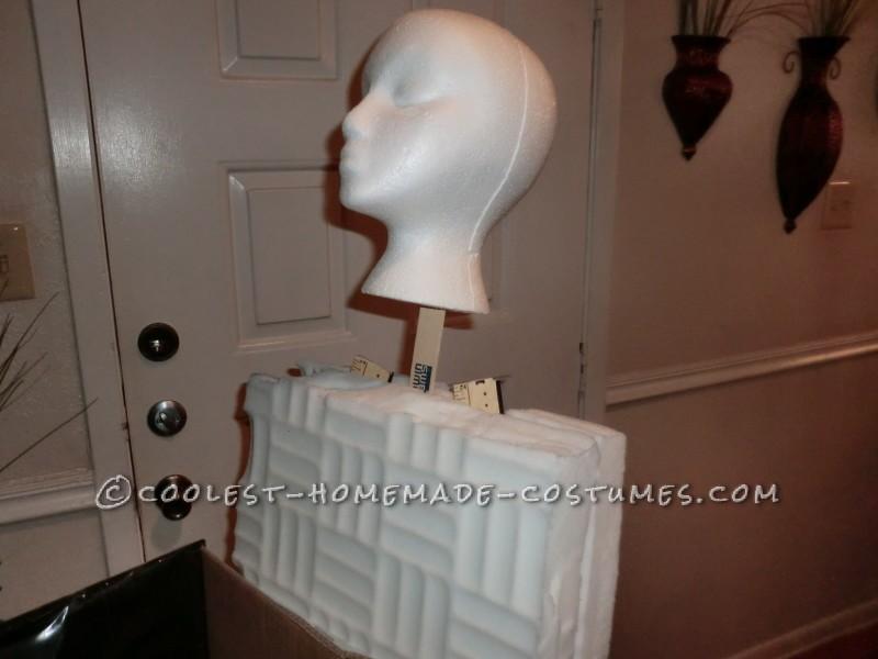 Styrofoam head attached to syrofoam body.
