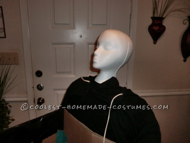 Body with light jacket that covers the back.