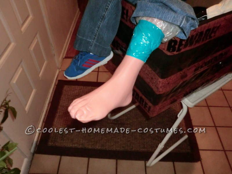 Plaster leg and foot attached to upper bubble wrap leg.