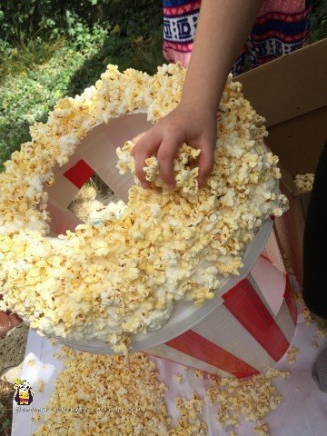 Adding the final nuggets of corn to the Popcorn costume
