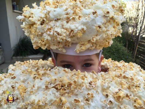 Peeking out of the Popcorn Costume