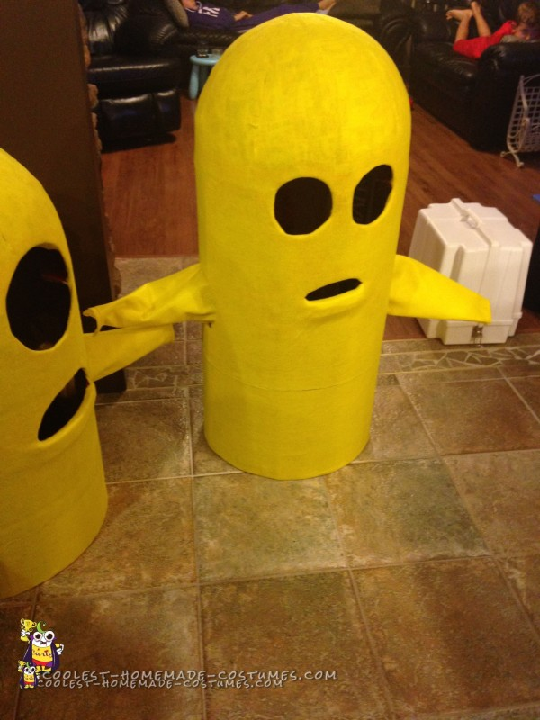 Minion Costumes covered in yellow felt with felt sleeves attached