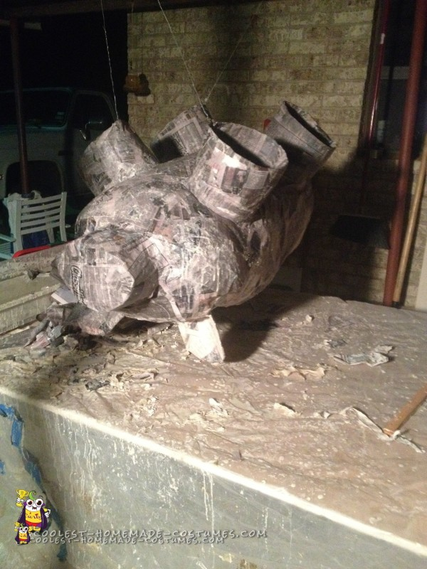 Topsy turvy paper mache piggy