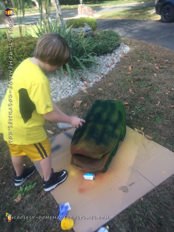 My 7 y/o learning how to spray paint