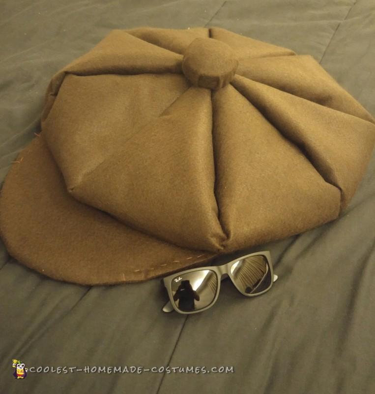 minion newsboy hat (felt)  I sew put it next to sunglasses to see how big it is.