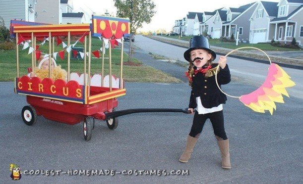 Step right up...Come one, Come all...Ringmaster Caileigh-Girl and her Caged Lion, Kyle-Guy, as oart of the Traveling-Trick-or-Treating Circus