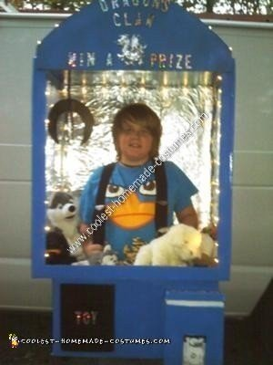 Homemade Kid in a Claw Machine Halloween Costume Idea