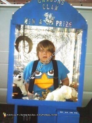 Homemade Kid in a Claw Machine Halloween Costume Idea